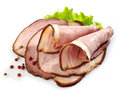 Smoked meat slices white background Royalty Free Stock Image