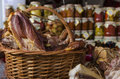 Smoked pork ham displayed in wicker basket in a food store Royalty Free Stock Image