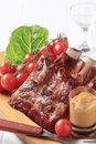 Smoked pork ribs and spicy sauce Royalty Free Stock Images