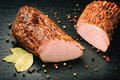 Smoked pork tenderloin on black board. Royalty Free Stock Photo