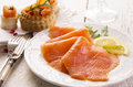Smoked salmon as closeup on a white plate Royalty Free Stock Image