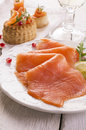 Smoked salmon as closeup on a white plate Royalty Free Stock Photos