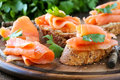 Smoked salmon canape delicious homemade garnished with a fresh parsley leaf Stock Image
