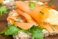 Smoked salmon and cream cheese canape garnished with herbs Royalty Free Stock Images