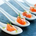 Smoked salmon delicatessen numerous porcelain spoons with morsels Stock Image