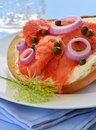 Smoked salmon lox on asiago cheese bagel with cream capers and red onion toasted Royalty Free Stock Image
