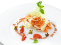Smoked salmon with mozzarella cheese served pomegranate sauce narsarab on a white round plate Royalty Free Stock Photos