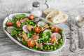 Smoked salmon, spinach, green peas, radish and tomato salad. Royalty Free Stock Photo