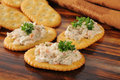 Smoked salmon spread on crackers whole wheat Royalty Free Stock Photo
