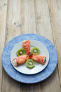 Smoked salmon stuffed with cream cheese garnished with avocado Stock Photography