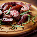 Smoked sausage with rosemary and peppercorns Stock Images