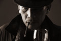 Smoker elderly gentleman portrait of an holding glass of wine with a cigarette hanging on his mouth Royalty Free Stock Images