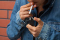 Smoker with lighter a a cigarette and a Royalty Free Stock Photography