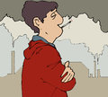 Smoker man outside smoking with chimneys in background Stock Image
