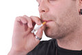 Smoker unshaved depressed young guy smoking a cigarette Royalty Free Stock Photo