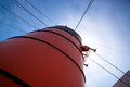Smokestack on cruise liner red with lines and rigging leading up to it Royalty Free Stock Image