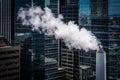 Smokestack and modern buildings in downtown toronto ontario Stock Image