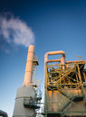 Smokestack petrochemical plant with morning blue sky Royalty Free Stock Image