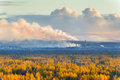 Smokestack smokestacks that pollute the atmosphere ecological catastrophy polar tundra deep autumn sunset bad lighting conditions Stock Images