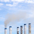 Smokestack a tall spewing out dirty polluted smoke Royalty Free Stock Photos