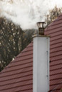 Smokestack on the tiled roof Royalty Free Stock Images