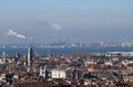 Smokestacks and factories polluting with smoke near venice in italy Stock Photo