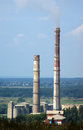 Smokestacks high of cement factory Stock Photos