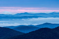 Smokey mountain mist dawn and clouds rise across the mountains from mt pisgah blue ridge parkway north carolina Royalty Free Stock Image