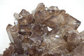 Smokey quartz crystals cluster of on white close up Stock Images