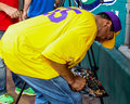 Smokey robinson signs autographs entertainer for fans at the jeffrey osborne foundation celebrity softball game Royalty Free Stock Photos