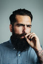 Smoking of bearded brutal man and stylish Royalty Free Stock Photos