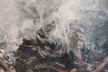 Smoking charcoal dense smoke of glowing Royalty Free Stock Photography