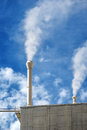 Smoking chimneys on an industrial building Royalty Free Stock Photo