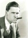 Smoking a cigar with attitude Royalty Free Stock Photo