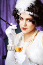 Smoking drinking flapper lady s Royalty Free Stock Images