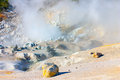 Smoking fumaroles of bumpass hell lassen volcanic park califor california visible yellow sulfur cristals Stock Photos