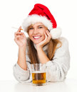 Smoking girl in red Santa hat drinking beer Royalty Free Stock Photo