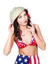 Smoking hot american military pin up girl wearing army green colander helmet on head while rollie undercover special forces Royalty Free Stock Photography