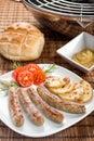Smoking hot nuremberg sausages or Bratwurst on plate. Royalty Free Stock Photo