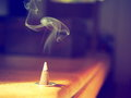 Smoking Incense Cone in Sunlight Royalty Free Stock Photo