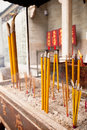 Smoking incense sticks at a temple in hong kong vertical shot Stock Photo