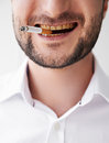 Smoking man with dirty yellow teeth close up photo of Royalty Free Stock Photo