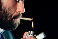Smoking man lighting and a joint Royalty Free Stock Photo