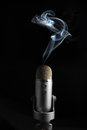 Smoking mic creative image depicting a microphone Stock Image