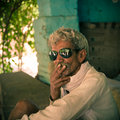 Smoking by old indian villager Stock Photo