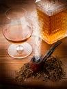 Smoking pipe and liquor Royalty Free Stock Image