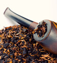 Smoking pipe and tobacco Stock Images