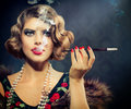 Smoking retro woman portrait beauty girl with mouthpiece Royalty Free Stock Photography