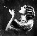 Smoking retro woman vintage styled black and white photo Royalty Free Stock Images