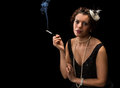 Smoking vintage woman s lady a cigarette with a mouthpiece Stock Photo